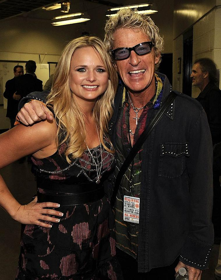 "Backstage, ""White Liar"" lady Miranda Lambert posed for a party pic with Kevin Cronin, frontman for ""Keep On Loving You"" band REO Speedwagon. She took a turn wowing the crowd by performing her own version of Merle Haggard's ""Tonight the Bottle Let Me Down."" Rick Diamond/<a href=""http://www.gettyimages.com/"" target=""new"">GettyImages.com</a> - October 5, 2010"
