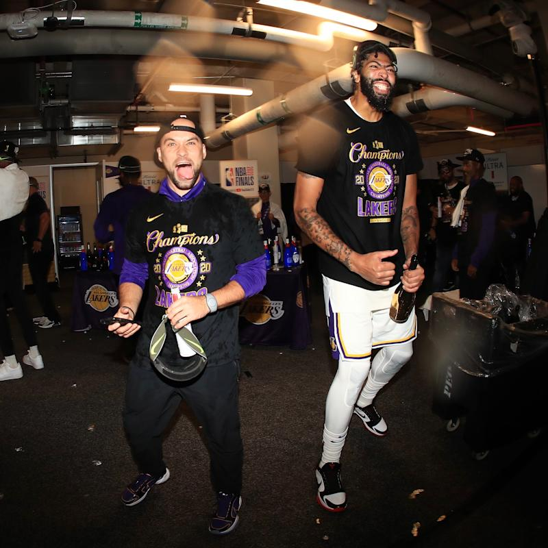 Former Michigan State basketball team manager Andrew Henk, left, celebrates with Anthony Davis in the locker room after the Los Angeles Lakers beat the Miami Heat for the NBA title on Oct. 11 in Orlando, Florida. Henk, a 29-year-old from Shelby Township, is the first-year equipment manager for the Lakers.