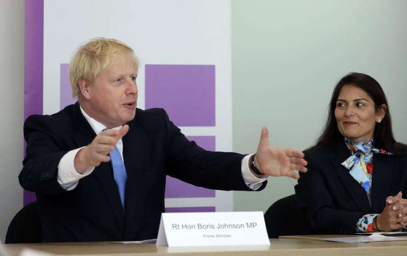 Prime Minister Boris Johnson with Home Secretary Priti Patel attending the first meeting of the National Policing Board at the Home Office in London.