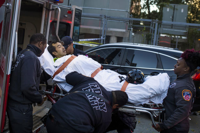 <p>Emergency personnel carry a man into an ambulance after a motorist drove onto a busy bicycle path near the World Trade Center memorial and struck several people Tuesday, Oct. 31, 2017, in New York. (Photo: Andres Kudacki/AP) </p>