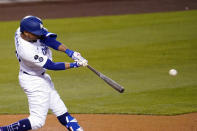 Los Angeles Dodgers' Mookie Betts connects for a double during the third inning of the team's baseball game against the Seattle Mariners on Wednesday, May 12, 2021, in Los Angeles. (AP Photo/Marcio Jose Sanchez)
