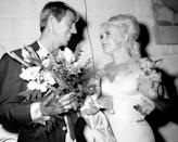 <p>Mansfield once again turned to the theater during a lull in her career, appeared in a production of <em>Gentlemen Prefer Blonde</em><em>s</em> at the Westbury. Here, her ex-husband, Mickey Hargitay, is seen greeting her with flowers after a performance. </p>