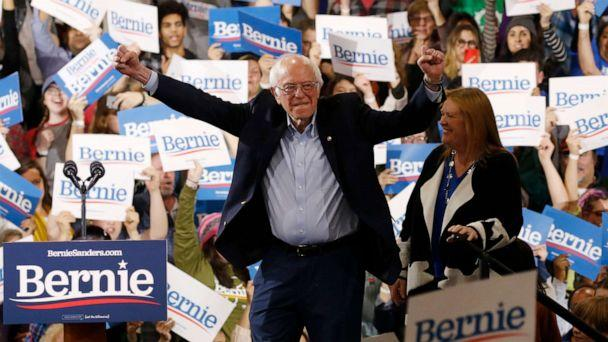 PHOTO: Democratic presidential candidate Sen. Bernie Sanders is accompanied by his wife Jane as he arrives to speak at his Super Tuesday night rally in Essex Junction, Vt., March 3, 2020. (Caitlin Ochs/Reuters)