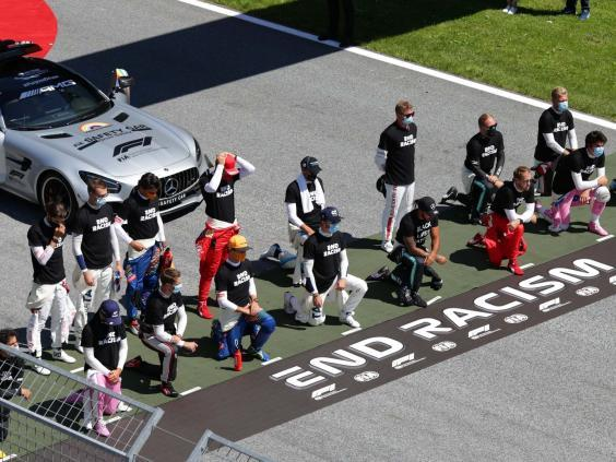 The six F1 drivers who chose not to stand made a mockery of the #WeRaceAsOne slogan (Getty)