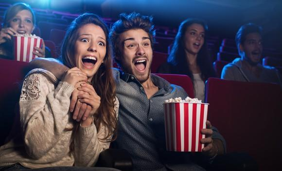 People showing fear at movie theater