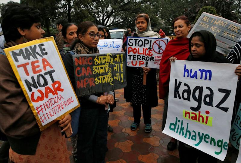 Demonstrators display placards as they attend a protest rally against a new citizenship law, in Kolkata