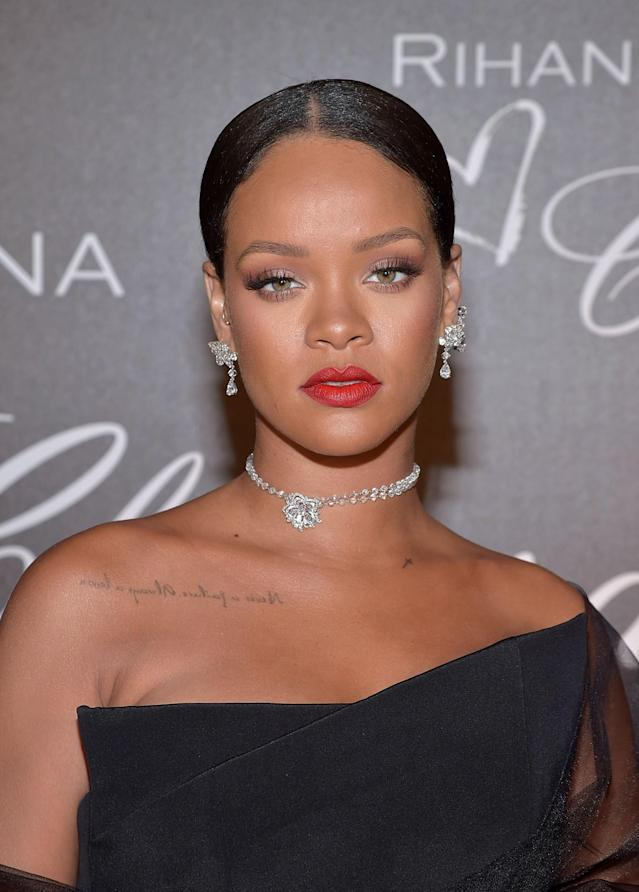<p>Rihanna can now add luxury jewelry designer to her list of credits. The singer attended a dinner in honor of her Chopard collection during Cannes rocking a slicked-back bun, long lashes, matte red lips, and her own jewels, of course. (Photo: Getty Images) </p>