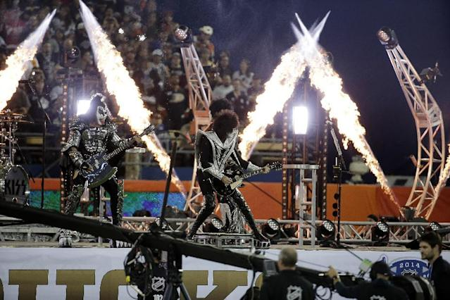 KISS plays prior to the Los Angeles Kings game against the Anaheim Ducks in an NHL outdoor hockey game at Dodger Stadium in Los Angeles, Saturday, Jan. 25, 2014. (AP Photo/Chris Carlson)