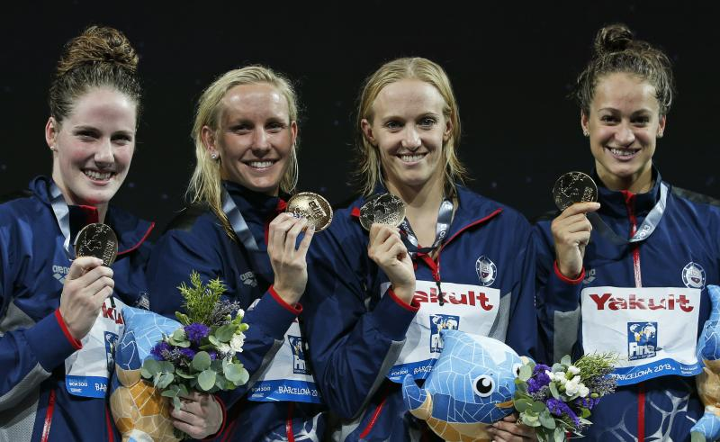 The United States Women's 4x100m medley relay team, from left: Missy Franklin, Jessica Hardy, Dana Vollmer and Megan Romano smile during the presentation ceremony after receiving their gold medals at the FINA Swimming World Championships in Barcelona, Spain, Sunday, Aug. 4, 2013. (AP Photo/Michael Sohn)