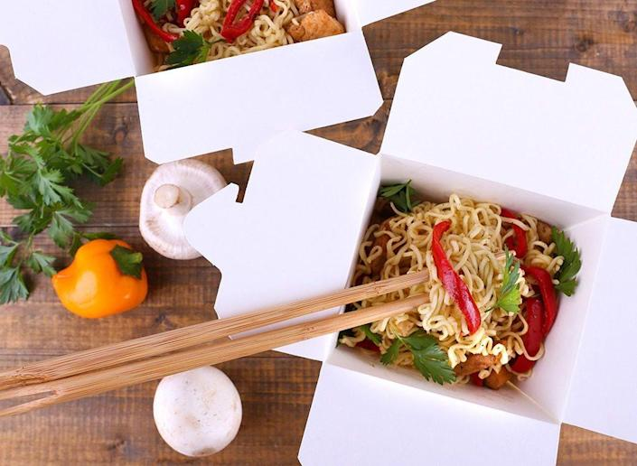 Chinese takeout with chopsticks
