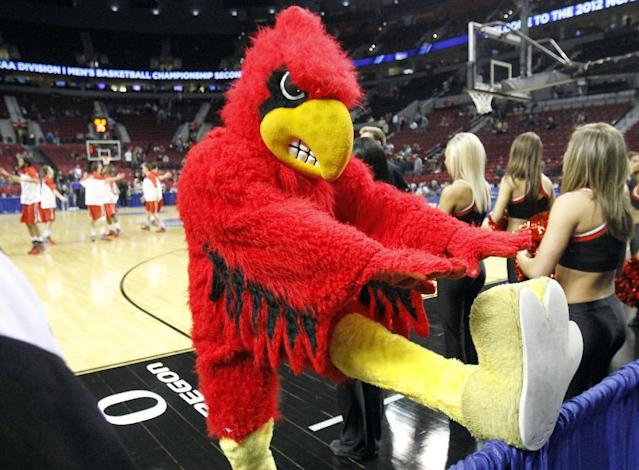 The Louisville Cardinals mascot stretches before their game against Davidson in an NCAA tournament second-round college basketball game in Portland, Ore., Thursday, March 15, 2012.(AP Photo/Don Ryan)