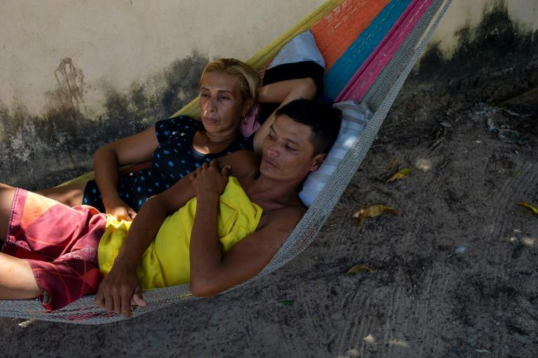 Homeless Venezuelans who fled the economic chaos in their home country sleep in a hammock by the side of the road in the Brazilian town of Boa Vista, where they are penniless and stranded