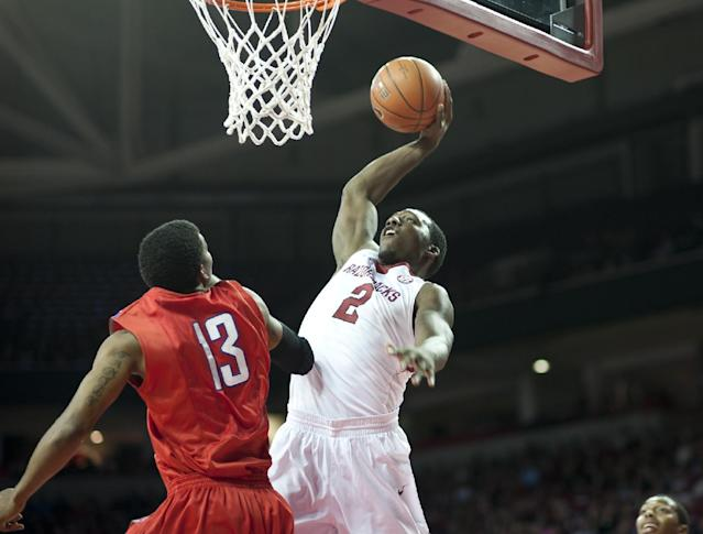 Arkansas' Alandise Harris (2) shoots a basket over SMU's Crandall Head (13) during the first half of an NCAA college basketball game in Fayetteville, Ark., Monday, Nov. 18, 2013. (AP Photo/Sarah Bentham)