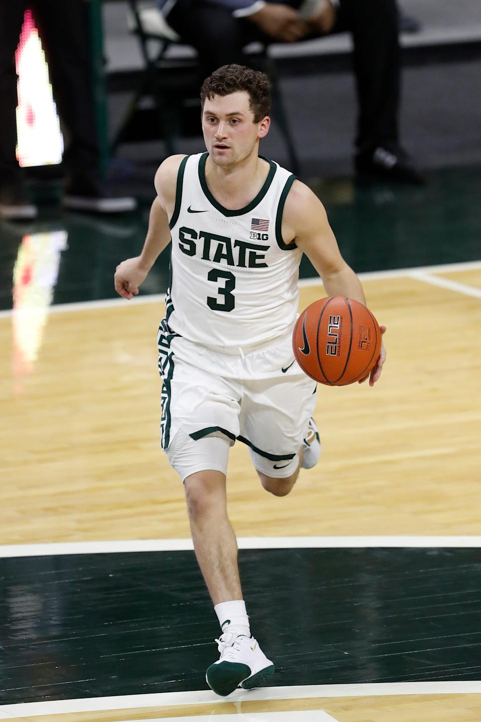 Michigan State's Foster Loyer dribbles the ball during the second half against Eastern Michigan, Nov. 25, 2020 in East Lansing.