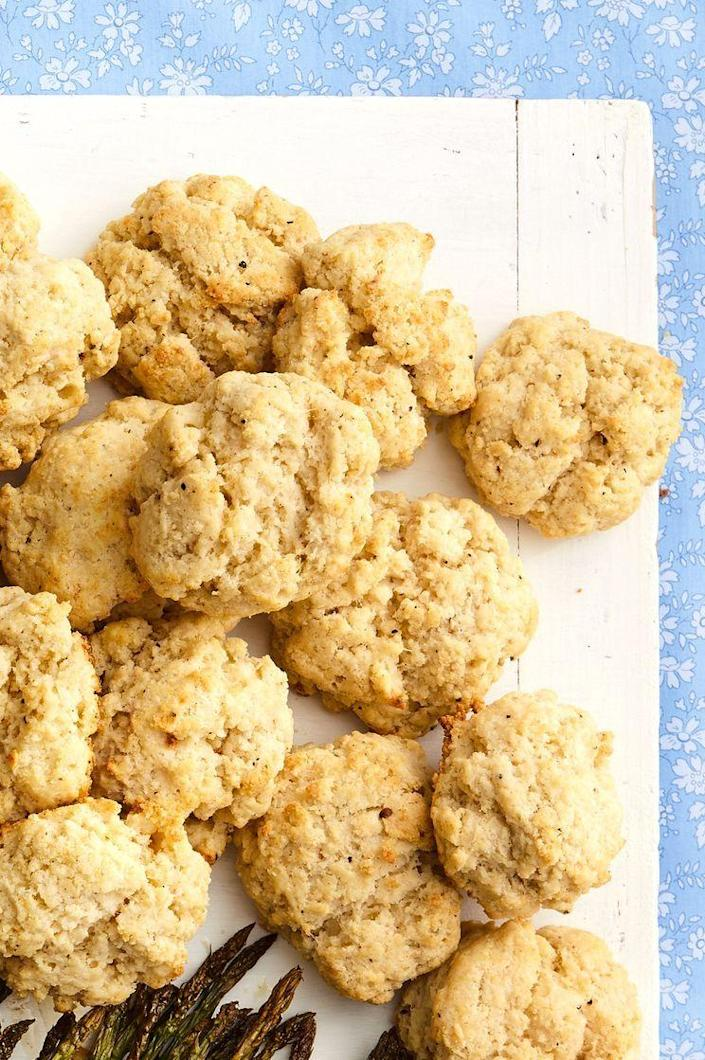 """<p>This is not your typical biscuit recipe—it's so much more! The addition of parmesan cheese and black pepper really gives them a kick. </p><p><a href=""""https://www.thepioneerwoman.com/food-cooking/recipes/a35568436/pepper-parmesan-biscuits-recipe/"""" rel=""""nofollow noopener"""" target=""""_blank"""" data-ylk=""""slk:Get Ree's recipe."""" class=""""link rapid-noclick-resp""""><strong>Get Ree's recipe.</strong></a></p>"""