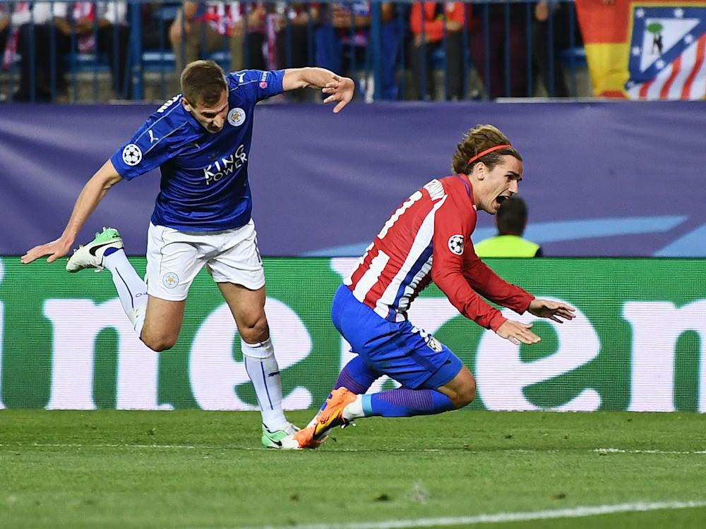 Marc Albrighton conceded a penalty when he tripped up Antoine Griezmann: Getty