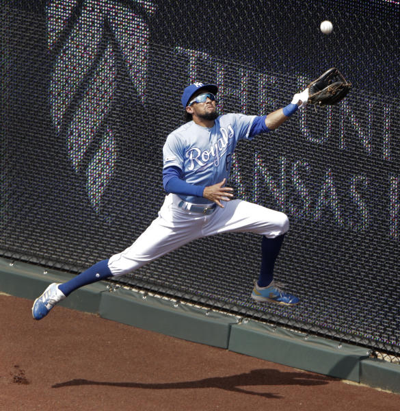 Kansas City Royals center fielder Billy Hamilton catches a fly ball for the out on New York Yankees' Clint Frazier during the sixth inning of the first baseball game in a doubleheader Saturday, May 25, 2019, in Kansas City, Mo. (AP Photo/Charlie Riedel)