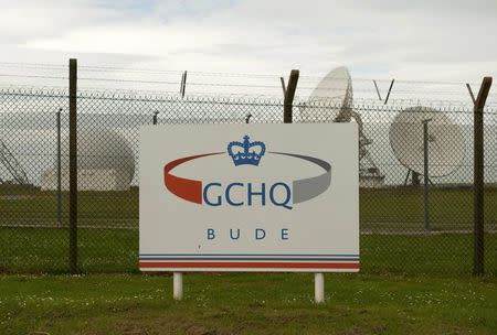 FILE PHOTO - Satellite dishes are seen at GCHQ's outpost at Bude, close to where trans-Atlantic fibre-optic cables come ashore in Cornwall, southwest England June 23, 2013. REUTERS/Kieran Doherty/File Photo