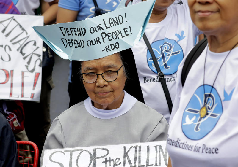 A Roman Catholic nun wears a boat-shaped hat with a message during a rally near the Philippine Congress to protest the 4th State of the Nation (SONA) address by President Rodrigo Duterte Monday, July 22, 2019 in suburban Quezon city, northeast of Manila, Philippines. Duterte is facing criticisms about his alleged closeness with China as well as the thousands of killings in his so-called war on drugs. (AP Photo/Bullit Marquez)