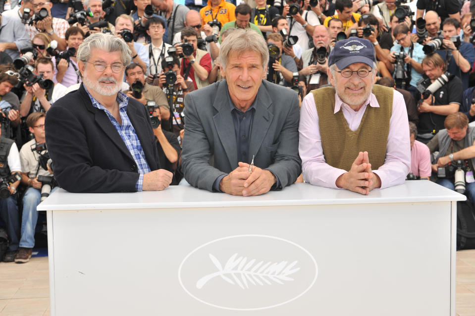 """Harrison Ford (C), George Lucas (L) and Steven Spielberg at the photo call of """"Indiana Jones and the Kingdom of the Crystal Skull"""" during the 61st Cannes Film Festival. (Photo by Stephane Cardinale/Corbis via Getty Images)"""