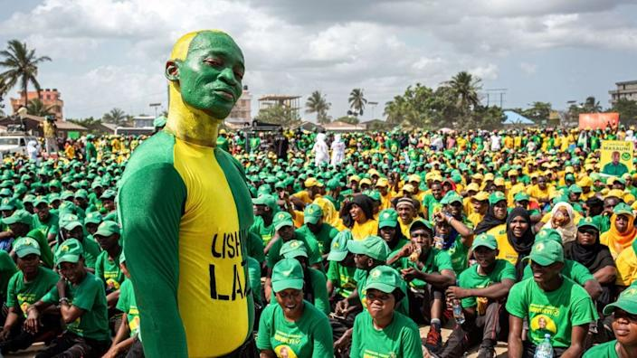 Supporters of the Tanzanian ruling party Chama Cha Mapinduzi (Revolutionary Party), gathered at the Kibanda Maiti Stadium, during the last campaign rally in Stone Town on October 25, 2020 ahead of the national elections.