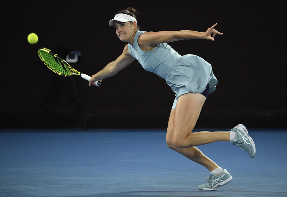 United States' Jennifer Brady hits a forehand return to Japan's Naomi Osaka during the women's singles final at the Australian Open tennis championship in Melbourne, Australia, Saturday, Feb. 20, 2021.(AP Photo/Andy Brownbill)
