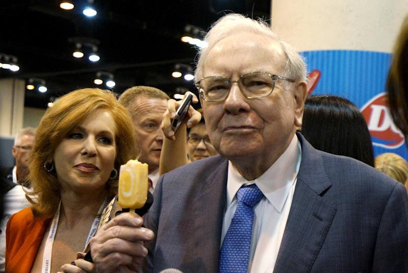 File photo of Berkshire Hathaway CEO Warren Buffett with a Dairy Queen ice cream bar prior to the Berkshire annual meeting in Omaha