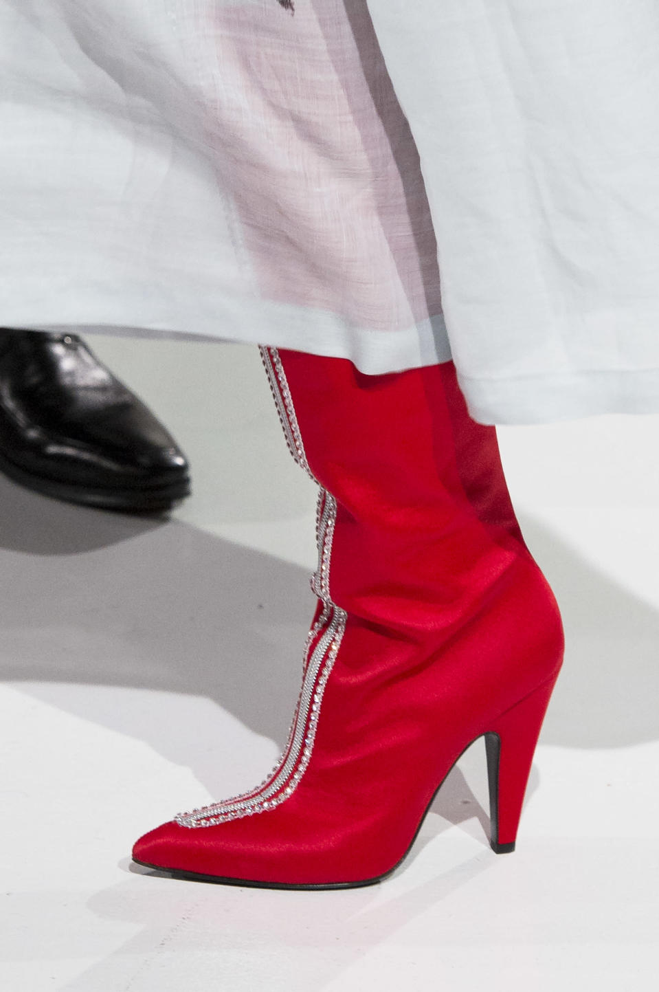 <p><i>Red boots with crystal embellishments from the SS18 Calvin Klein collection. (Photo: ImaxTree) </i></p>