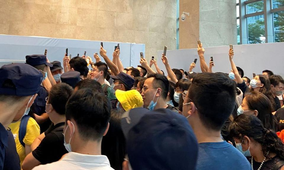 People demand repayment of loans and financial products at the Evergrande's headquarters in Shenzhen.