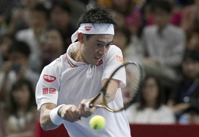 Kei Nishikori of Japan returns a shot against Daniil Medvedev of Russia during their single's final match at the Japan Open men's tennis tournament in Tokyo Sunday, Oct. 7, 2018. (AP Photo/Eugene Hoshiko)