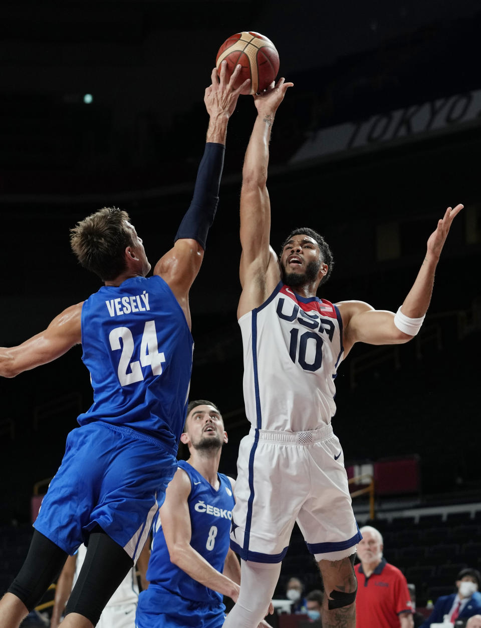 United States's Jayson Tatum (10) is blocked by Czech Republic's Jan Vesely (24) during a men's basketball preliminary round game at the 2020 Summer Olympics, Saturday, July 31, 2021, in Saitama, Japan. (AP Photo/Eric Gay)