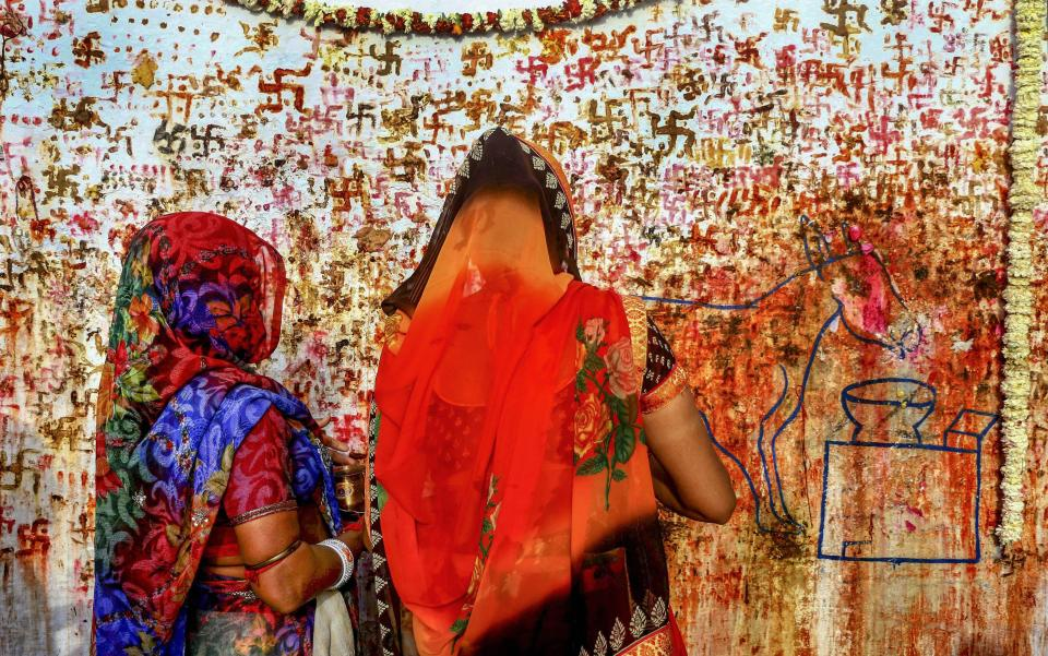 Hindu devotees perform rituals on the occasion of Sheetala Saptami festival in Ajmer on 27 March.