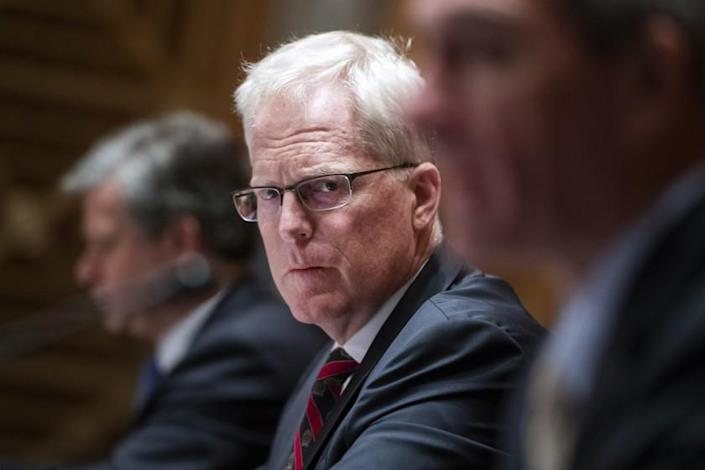 """National Counterterrorism Center Director Christopher Miller listens during a Senate Homeland Security and Governmental Affairs Committee hearing on """"Threats to the Homeland"""" Thursday, Sept. 24, 2020 on Capitol Hill in Washington. (Tom Williams/Pool via AP)"""