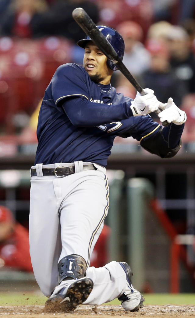 Milwaukee Brewers' Carlos Gomez tries to check his swing in the fifth inning of a baseball game against the Cincinnati Reds, Thursday, May 1, 2014, in Cincinnati. Gomez walked in the at bat. (AP Photo/Al Behrman)
