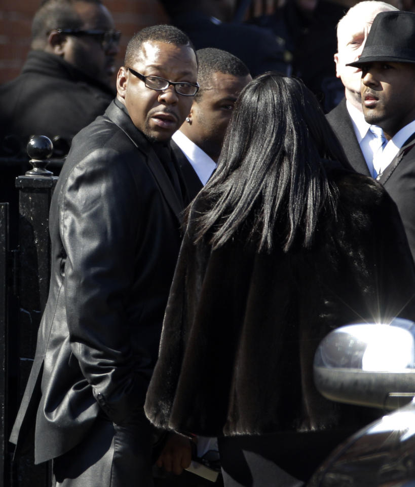 Singer Bobby Brown, left, is seen outside during the funeral of his ex-wife Whitney Houston at New Hope Baptist Church in Newark, N.J., Saturday, Feb. 18, 2012. Houston died last Saturday at the Beverly Hills Hilton in Beverly Hills, Calif., at the age 48. (AP Photo/Mel Evans)