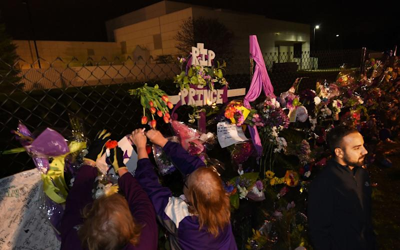 Fans of Prince outside his Paisley Park home in April 2016, the day after his death - AFP or licensors