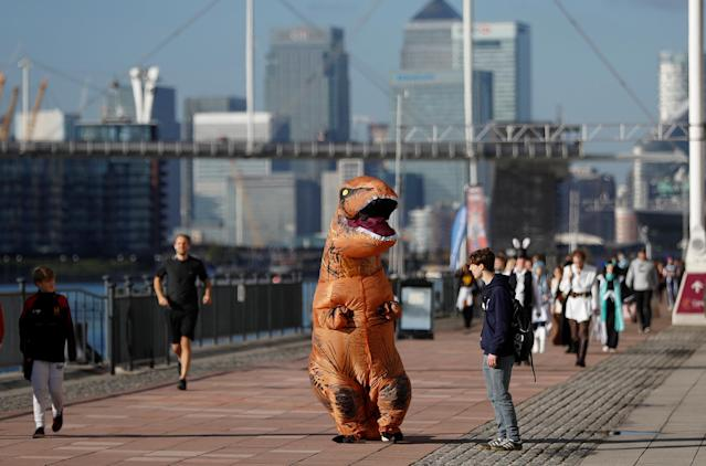 A visitor wearing a T-Rex costume arrives at the London Comic Con, at the ExCel exhibition centre in east London, Britain October 27, 2017. REUTERS/Peter Nicholls