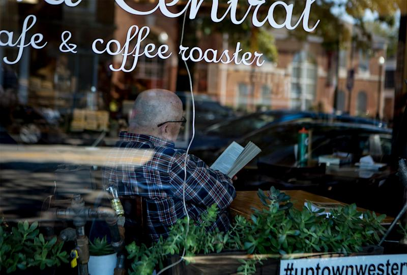 A man reads inside Java Central in downtown Westerville. Westerville and Otterbein University are playing host to the upcoming democratic debates.