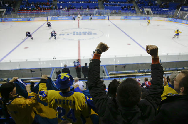 Fans cheer at the start of play between Sweden and the USA during a 2014 Winter Olympics women's semifinal ice hockey game at Shayba Arena Monday, Feb. 17, 2014, in Sochi, Russia. (AP Photo/Matt Slocum)
