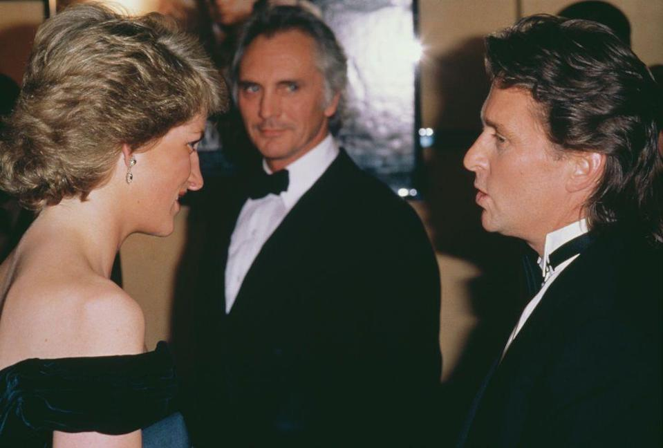 <p>In true '80s fashion, Michael Douglas rocked a mullet with his formal tuxedo. The American actor met the Princess while attending the London premiere of his hit movie, <em>Wall Street</em><em>. </em></p>