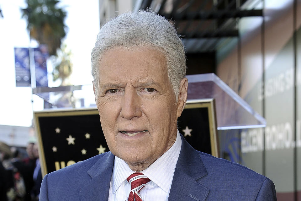 """FILE - Alex Trebek, host of """"Jeopardy!"""" attends a ceremony honoring the show's executive producer Harry Friedman with a star on the Hollywood Walk of Fame in Los Angeles, in this Friday, Nov. 1, 2019, file photo. """"Jeopardy!"""" host Alex Trebek died Sunday , Nov. 8, 2020, after battling pancreatic cancer for nearly two years. Trebek died at home with family and friends surrounding him, """"Jeopardy!"""" studio Sony said in a statement. Trebek presided over the beloved quiz show for more than 30 years. (Photo by Richard Shotwell/Invision/AP, File)"""