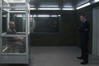 James Bond (Daniel Craig) visits Blofeld (Christoph Waltz) in his prison cell in NO TIME TO DIE, a DANJAQ and Metro Goldwyn Mayer Pictures film. (Credit: Nicola Dove. © 2019 DANJAQ, LLC AND MGM. ALL RIGHTS RESERVED.)