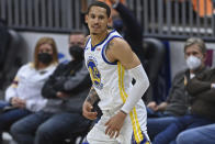 Golden State Warriors' Juan Toscano-Anderson (95) smiles after a three-point basket in the second half of an NBA basketball game against the Cleveland Cavaliers, Thursday, April 15, 2021, in Cleveland. (AP Photo/David Dermer)