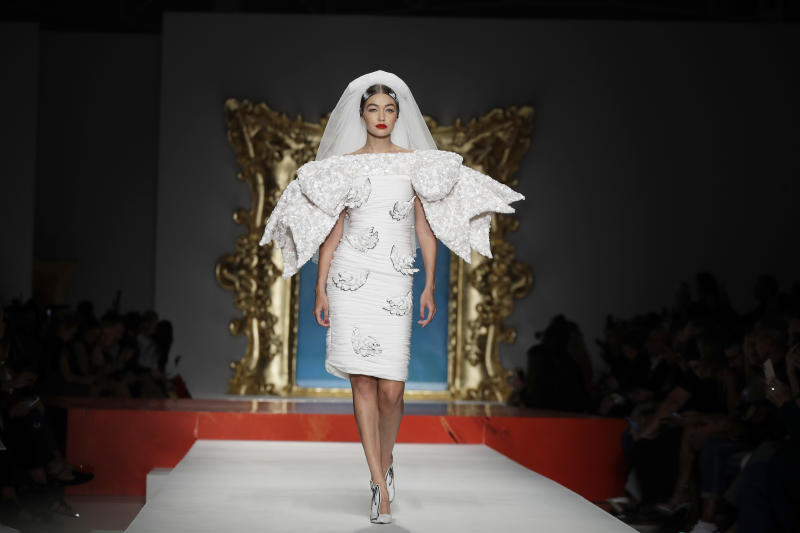 Model Gigi Hadid wears a creation as part of the Moschino Spring-Summer 2020 collection, unveiled during the fashion week, in Milan, Italy, Thursday, Sept. 19, 2019. (AP Photo/Luca Bruno)