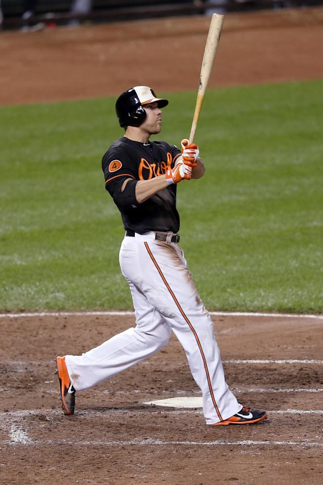 BALTIMORE, MD - SEPTEMBER 06: Chris Davis #19 of the Baltimore Orioles follows his solo home run against the Chicago White Sox during the sixth inning at Oriole Park at Camden Yards on September 6, 2013 in Baltimore, Maryland. (Photo by Rob Carr/Getty Images)
