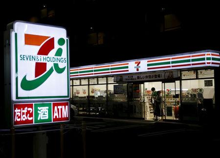 FILE PHOTO: Shoppers walk out from a Seven & I Holdings' 7-Eleven convenience store in Tokyo, Japan, April 7, 2016.  REUTERS/Yuya Shino/File Photo