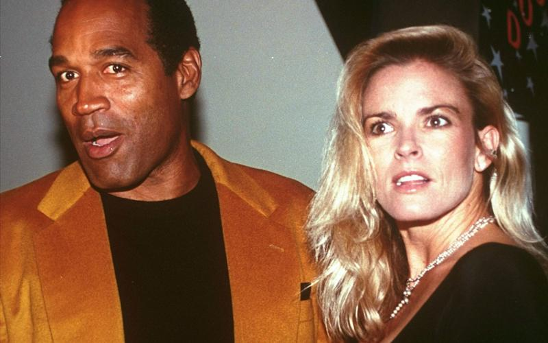 OJ Simpson and Nicole Brown Simpson pictured in 1993.  - Credit: AP