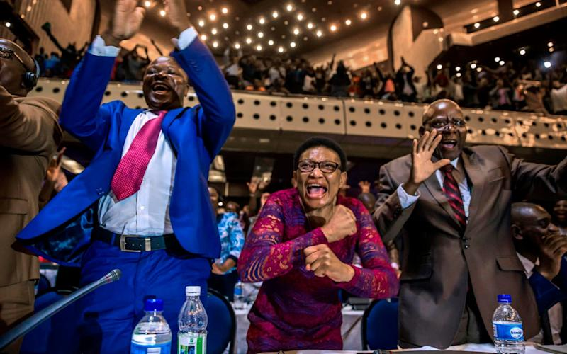 Zimbabwe's MP's erupt into celebration after President Robert Mugabe's resignation  - AFP