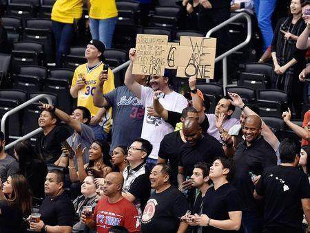 Fans hold a sign prior to the game between the Golden State Warriors and Los Angeles Clippers in game five of the first round of the 2014 NBA Playoffs at Staples Center. Kelvin Kuo-USA TODAY Sports - RTR3N6FJ
