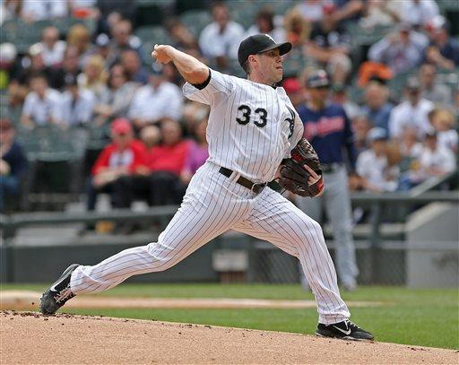 Chicago White Sox starting pitcher Dylan Axelrod throws against the Cleveland Indians in the first inning of a baseball game in Chicago, Saturday, June 29, 2013. (AP Photo/Charles Cherney)